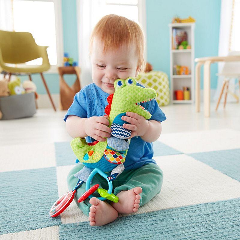 תנין פעילות נתלה לתינוק - פישר פרייס